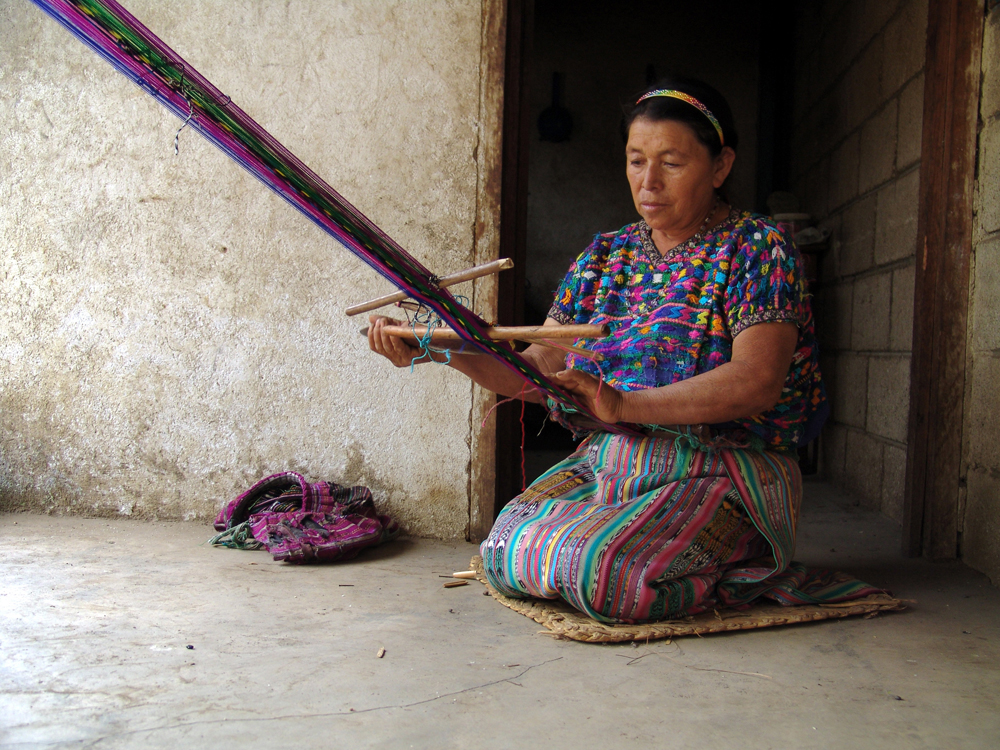 Guatemalan Woman Weaving on a Traditional Back Strap Loom