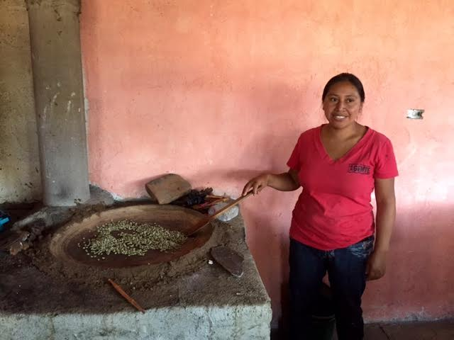 Marta roasting coffee beans in her family's kitchen