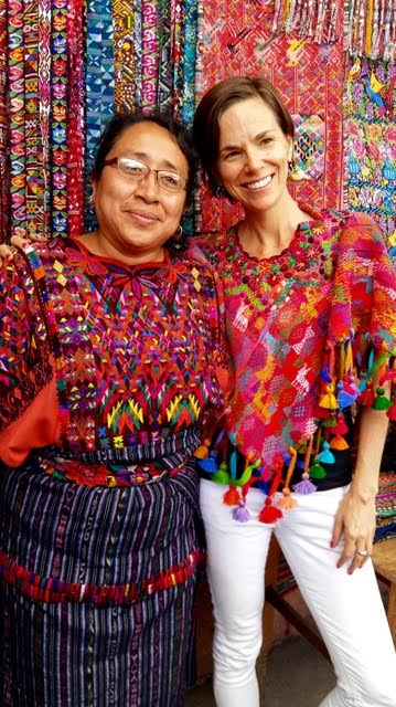 With Lidia wearing her traditional indigenous maya clothing: including a stunning hand-woven faja/belt